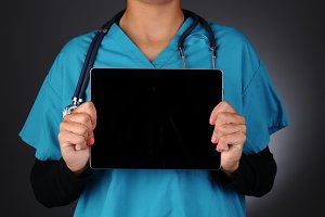 Nurse Holding Tablet Computer