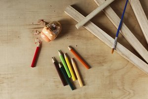 Colored pencils on a wooden board
