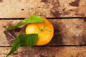 Orange mandarin on the wooden boards