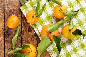Orange mandarins on the wooden boards