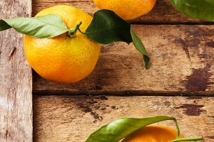 Orange mandarins on the wooden boards