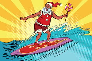 Sports Santa Claus on a surfboard