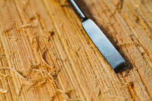 wood chips and cutters lie on a wooden board close-up