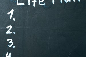LIFE PLAN phrase written in chalk on the blackboard.