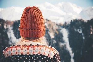 Woman enjoying winter mountains