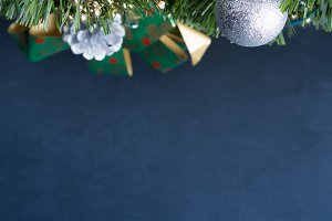 Dark Christmas background with baubles. Copy space