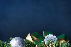 Dark blue background with Christmas baubles. Copy space