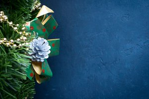 Dark blue Christmas background with baubles and copy space