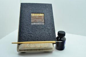 lectern,notepad, pen, inkwell