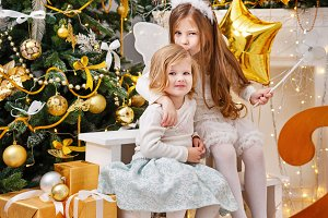 Two sisters, gifts, Christmas tree