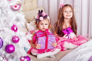 Two girls with gifts for Christmas