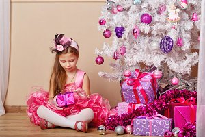 Girl looking for Christmas gift