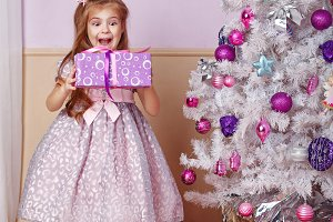 Girl is holding a Christmas present