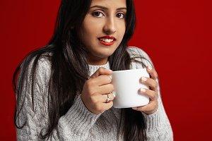Christmas portraits of woman drinkig