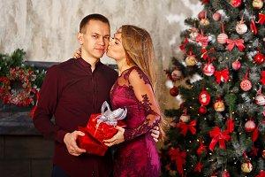 Girl kisses a guy on Christmas