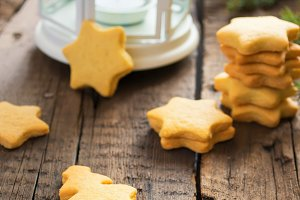 Homemade cookies Christmas tree and star on a background of bran