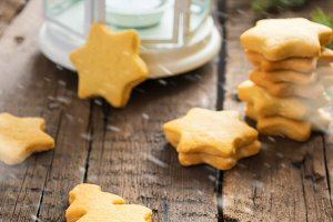 Cookies, lantern and tree branches on an old wooden table. Chris