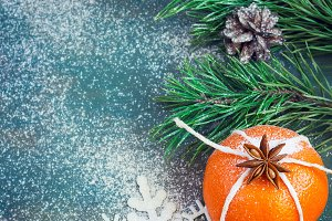 Christmas composition with tangerine, candles, snowflakes and fir branches. with space for text