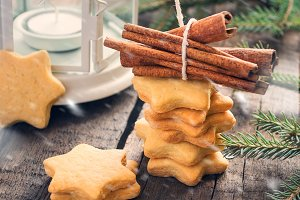 Christmas cookies stars with cinnamon and  Lantern. Style rustic
