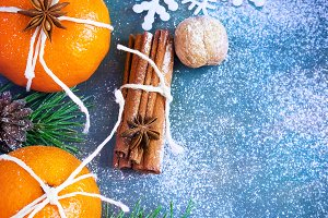 Tangerines, cinnamon, nuts and snowflake as the Christmas Decor.