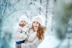 Mother and daughter in winter forest