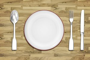 Dinner plate with cutlery spoon