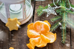 Christmas decorations: flashlight, tangerine, ginger biscuits, s