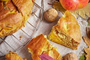 Apple pie, apples, walnuts and honey. Autumn Still Life
