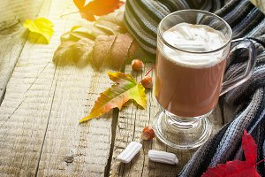Cocoa with marshmallows, scarf and autumn leaves, tinted, with s