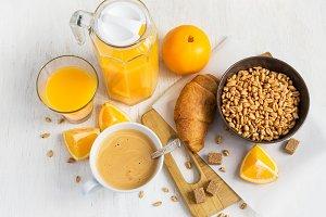Breakfast concept - orange juice, croissant, coffee and wheat ai