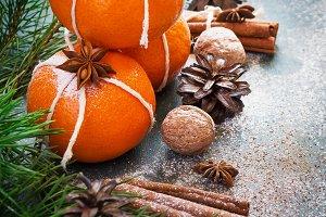 Winter Christmas decorations - tangerines, walnuts, cinnamon