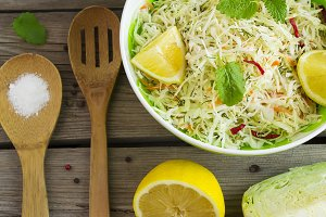 Vitamin cabbage salad with carrots and lemon juice, top view