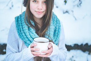 Beautiful woman drinking hot drink