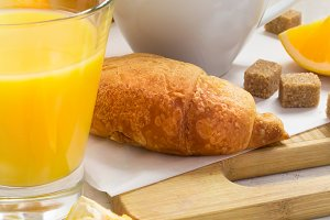Croissants, coffee and orange juice. Breakfast concept.