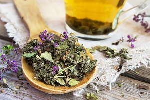 Wooden spoon with dry herbal tea.
