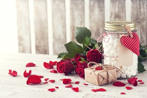Love concept with roses and gifts