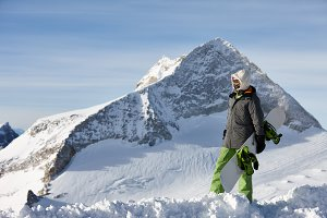 Snowboarder watching mountain landscape