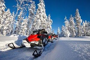 Snowmobiles in snowy Finland