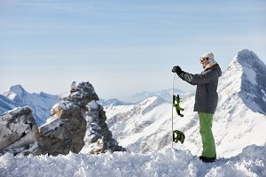 Snowboarder watching mountain landscape