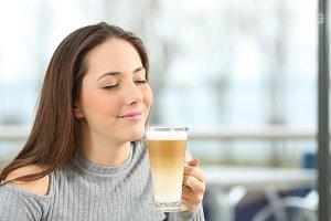 Woman enjoying a macchiato