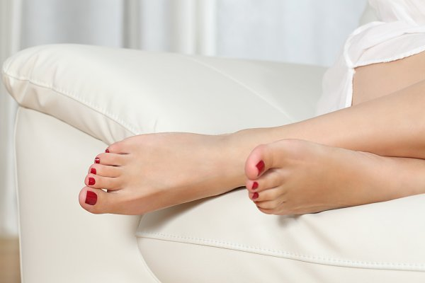 Woman feet with red nails