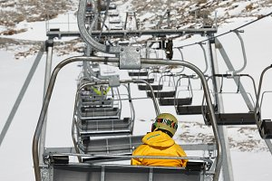 Snowboarder elevating on chairlift