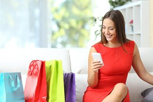 Woman in red using a smart phone