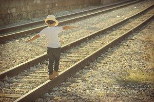 Child on the train tracks