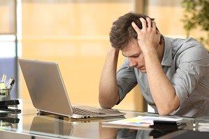 Worried businessman lamenting