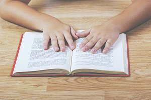 Child hands with a book