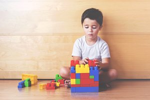 Boy playing with blocks of colors