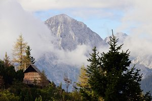 Cottage and the Mountains in Autumn