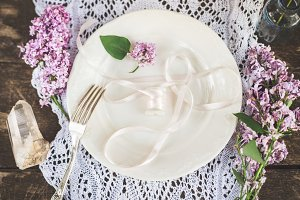 Beautiful spring table set up with boho flower decoration.