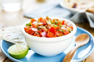 Tomato salsa by tortilla and toast